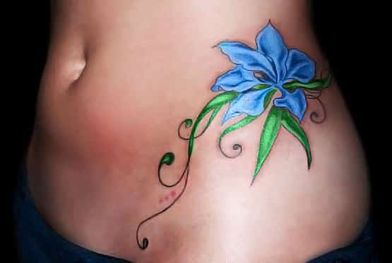 blue flower lower back tattoo designs