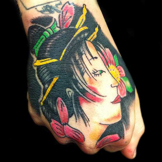 Geisha on fists tattoo