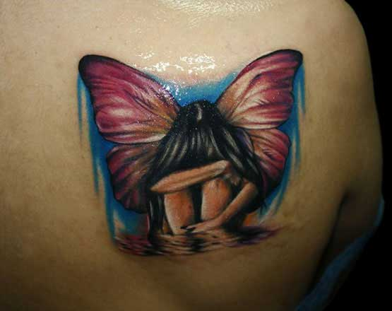 Fairy tattoo on women's back