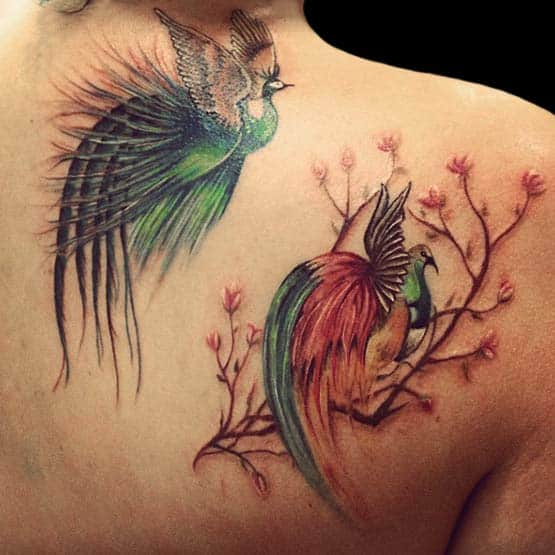 Girl With Bird Tattoo On Her Back